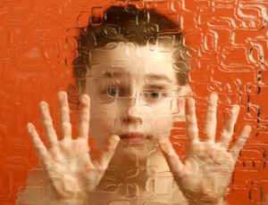 autism child behind screen1 300x230 Autism and Insomnia   Melatonin Improves Kids Sleep Disorders
